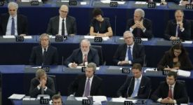 The college of European Commissioners listens as Jean-Claude Juncker, the incoming president of the European Commission, delivers his speech during their presentation at the EU Parliament in Strasbourg